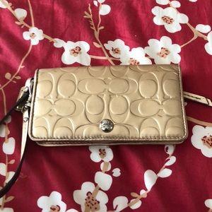 Handbags - Coach Gold Embossed Wristlet